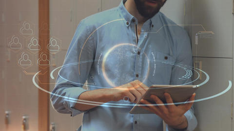 Man using his digital tablet surrounded by technological animation Animation