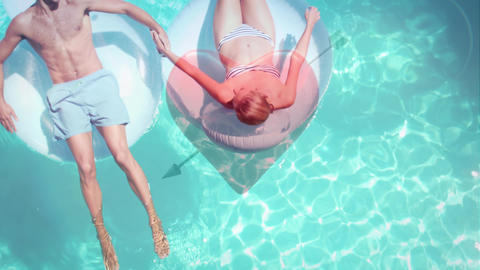 Couple lying on float in pool Animation