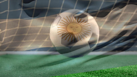 Soccer ball bouncing on grass while Argentinian flag waves on the foreground on soccer field Animation