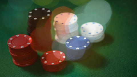 Animation of poker chips and cards on green table Animation