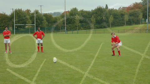 Group of multi ethnic rugby players playing football on football field Animation
