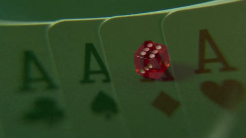 Dice rolling over green table Animation