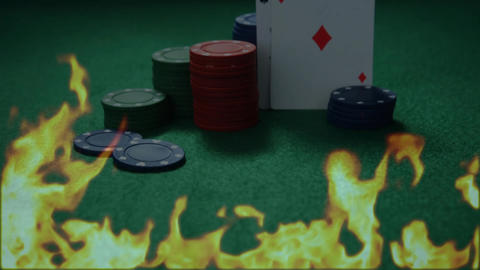 Poker chips and cards on a poker tables with fire burning Animation