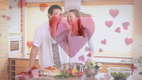 Couple having fun and cooking at home with digital hearts Animation