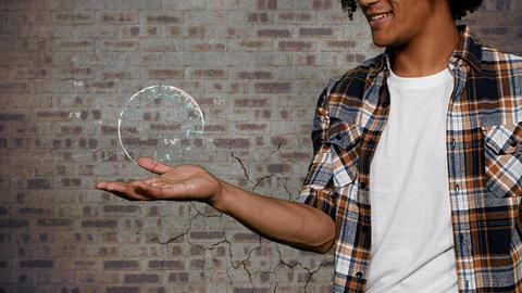 Man holding globe against brick wall 4k Animation