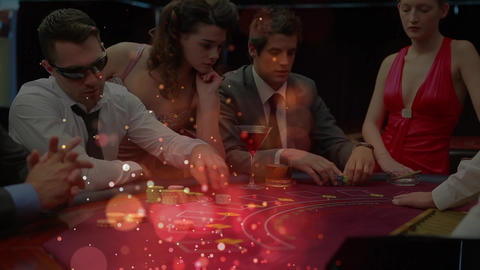 Poker players around a poker table with animation of light effects in the foreground Animation
