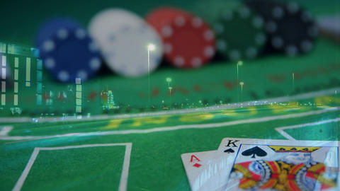 Casino table with chips and cards and shining highway Animation