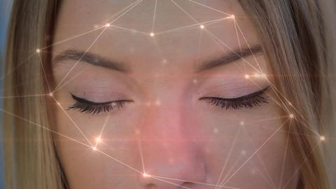 Light connections moving on a background with a women opening her eyes Animation