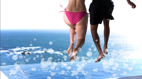 Young couple jumping into a swimming pool surrounded by white bubbles Animation