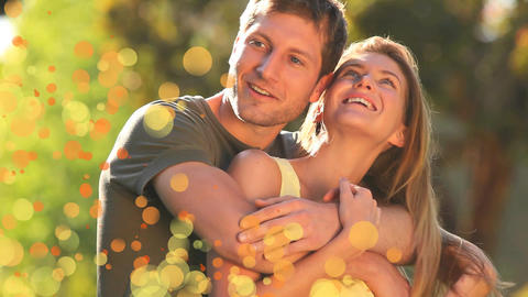 Couple in the garden surrounded by an animation of orange bubbles Animation
