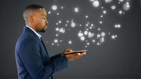 African-american holding digital tablet on hands. Pressing on screen and looking upward with bubble Animation