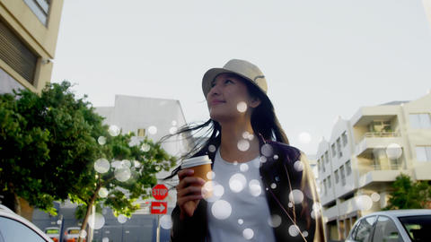 Young woman walking in the street surrounded by white bubbles Animation