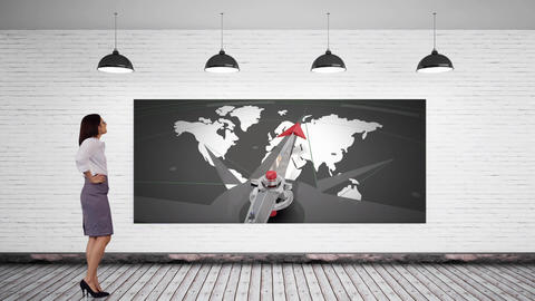 Businesswoman locking at a screen with a world map Animation