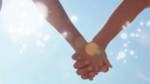 Couple hand in hand surrounded by bokeh effect Animation