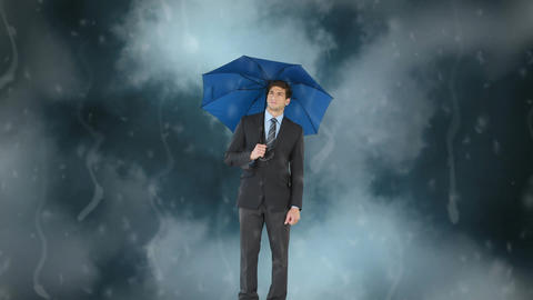Businessman with his umbrella under the storm Animation