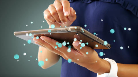 Woman using digital tablet surrounded by white bubbles effect Animation