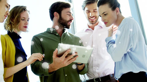 Coworkers discussing over digital tablet surrounded by white bubbles effect Animation
