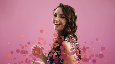 Woman dancing surrounded by bubbles effect against pink background Animation