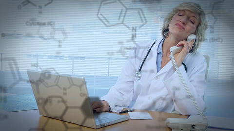 Doctor working on a laptop while talking on the phone Animation