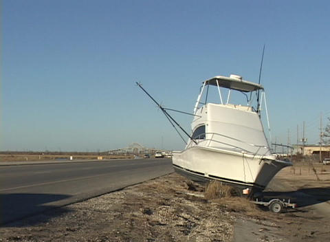 A boat rests alongside a highway after Hurricane Katrina Stock Video Footage