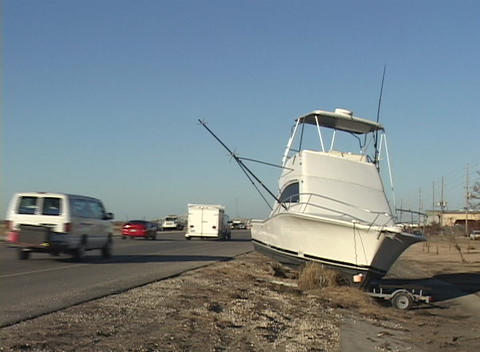 A boat rests alongside a highway after Hurricane Katrina Footage