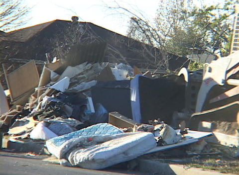 A bulldozer shovels up household remains after Hurricane... Stock Video Footage