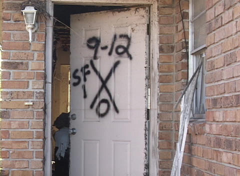 The markings on the door of a house shows the number of survivors and deaths after Hurricane Katrina Live Action