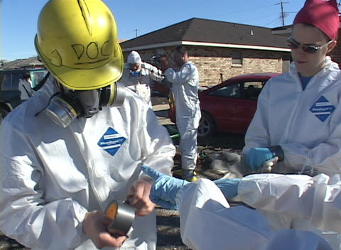 Rescue and relief workers wear respirators in a... Stock Video Footage
