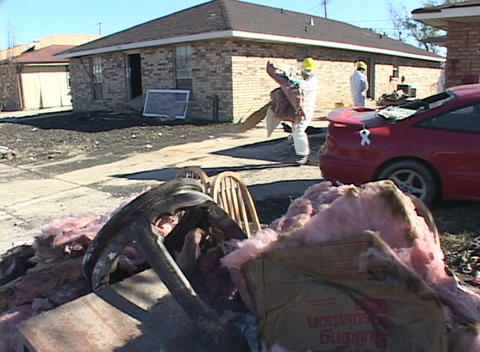 Relief workers clean up destroyed houses after Hurricane... Stock Video Footage