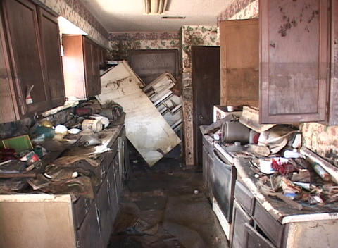 A kitchen shows the destructive power of the flood waters... Stock Video Footage