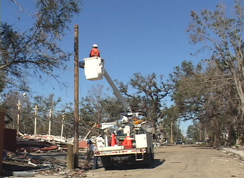 A utility crew inspects power lines after Hurricane Katrina Stock Video Footage