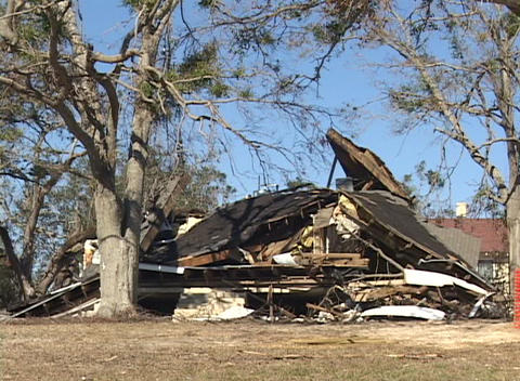 A house reduced to a pile of rubble shows the destruction of Hurricane Katrina Footage