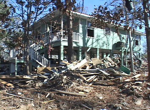 A damaged building stands amidst the rubble due to... Stock Video Footage