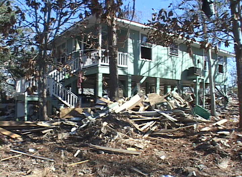 A damaged building stands amidst the rubble due to Hurricane Katrina Footage