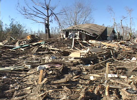 A single home stands after Hurricane Katrina leveled the rest of the neighborhood Footage
