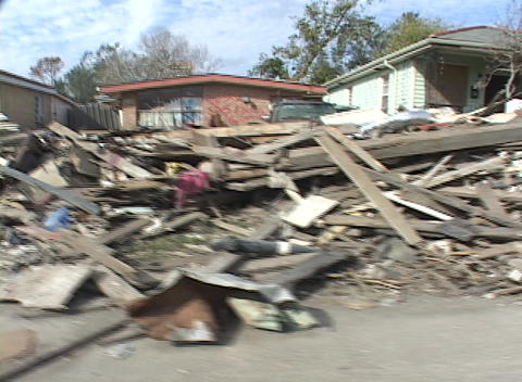 Rubble and debris piled along the side of the road shows... Stock Video Footage