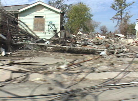 Rubble and debris piled along the side of the road shows the destruction caused by Hurricane Katrina Footage