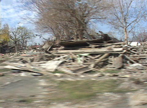 Rubble and debris has been piled on the side of the road... Stock Video Footage