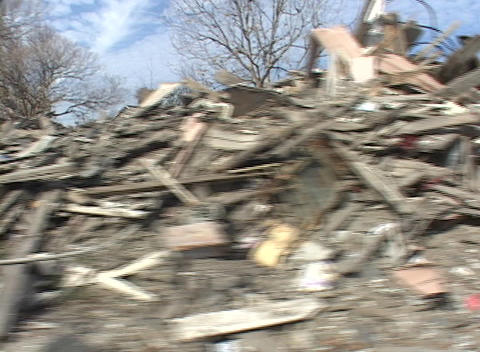 Rubble and debris has been piled on the side of the road shows the destruction caused by Hurricane K Footage