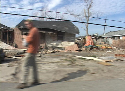 Homes and vehicles in what was a neighborhood show the destruction caused by Hurricane Katrina Footage