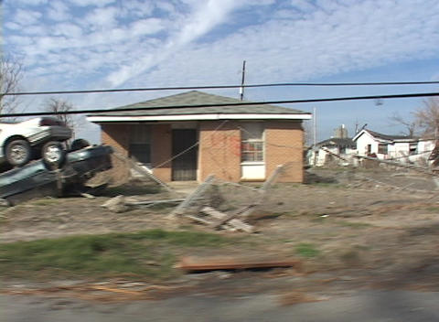 Homes and vehicles in what was a neighborhood show the... Stock Video Footage
