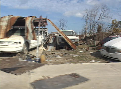 Complete destroyed homes and vehicles show the destruction caused by Hurricane Katrina Footage