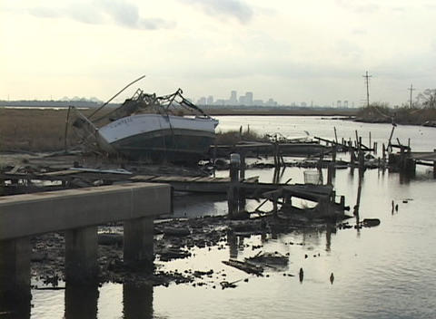A fishing boat lays on its side on the shore after Hurricane Katrina Footage