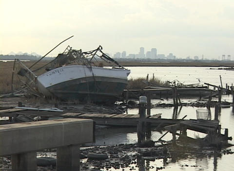 A fishing boat lays on its side on the shore after... Stock Video Footage