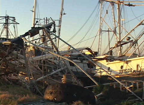 Fishing boats strewn about a harbor area show the destruction caused by Hurricane Katrina Footage