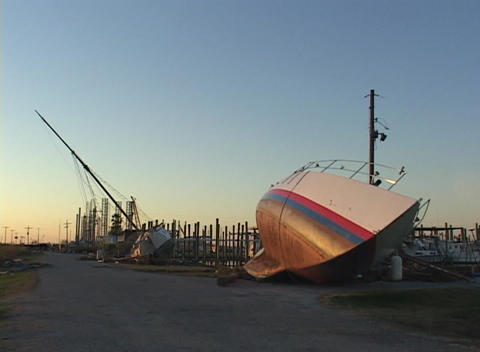 Boats rest on their sides ion the beach following... Stock Video Footage