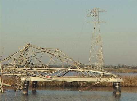 Medium shot of destroyed power lines and towers following Hurricane Katrina Footage