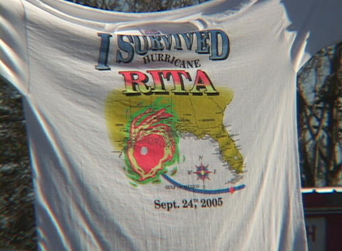 Close-up shot of a tee shirt that reads, I Survived... Stock Video Footage