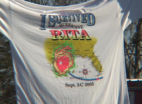 "Close-up shot of a tee shirt that reads, I Survived Hurricane Rita."""" Footage"