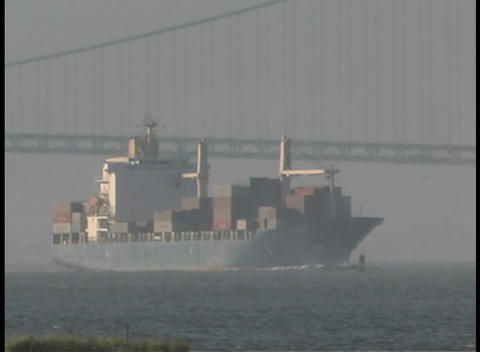 A cargo ship passes under the Manhattan Bridge Footage